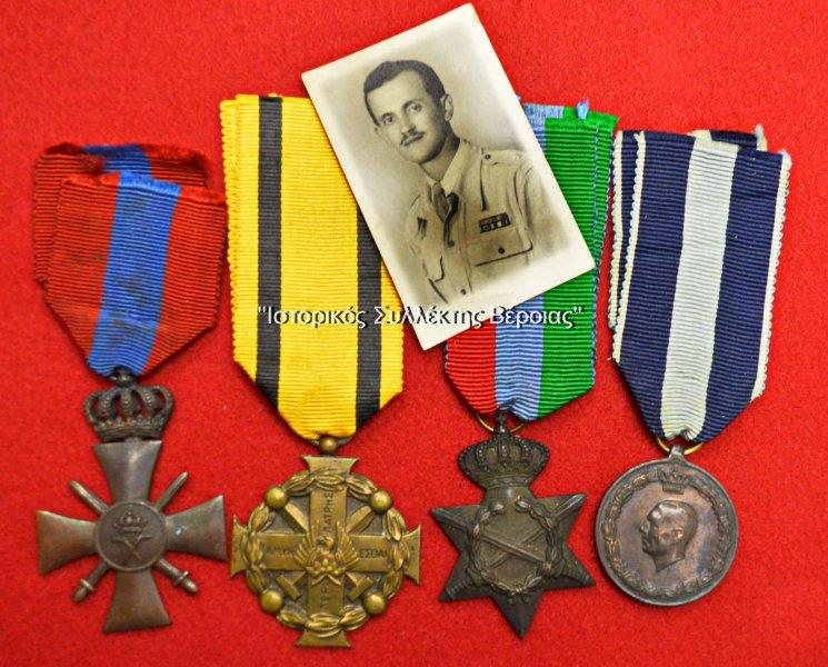 Μετάλλια και φωτογραφία του έφεδρου Υπολοχαγού (ΠΒ) Ευγενίδη Ιωάννη από την Βέροια, ο οποίος πολέμησε ως ΔΕΑ, ως έφεδρος Ανθυπολοχαγός και έφεδρος Υπολοχαγός από το 1940 έως το 1949. Τα μετάλλια με τα οποία τον τίμησε η Ελλάδα για τις υπηρεσίες που πρόσφερε στην πατρίδα του είναι (από αριστερά) ο Πολεμικός Σταυρός Γ΄Τάξεως, το Μετάλλιο Εξαίρετων Πράξεων, το Αναμνηστικό Μετάλλιο 1941-45, και το Αναμνηστικό Μετάλλιο 1940-41 (δωρεά της οικογένειας Ευγενίδη εκ Βέροιας).
