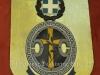 Μεταλλικός θυρεός με το έμβλημα της Ελληνικής Χωροφυλακής περιόδου 1974-1984, ο οποίος ήταν τοποθετημένος στην είσοδο του εκάστοτε Αστυνομικού Σταθμού της Χωροφυλακής.