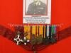 Φωτογραφία του Ταξίαρχου ε.α. Χριστόπουλου Δημήτριου (1912-2007) με τα μετάλλια εντός κορνίζας όπως εκτίθενται πλέον στο Βλαχογιάννειο Μουσείο, μετάλλια με τα οποία τιμήθηκε ο εν λόγω αξκος για την προσφορά του στην Πατρίδα, μαχόμενος στο Ελληνο-Αλβανικό Μέτωπο 1940-1941, λαμβάνοντας μέρος στην Εθνική Αντίσταση, Μαχόμενος στην Μέση Ανατολή 1943-1944, και τέλος λαμβάνοντας μέρος στο Συμμοριτοπόλεμο 1947-1949 (δωρεά κ.Παναγιώτη Γιολάνδη).
