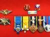Μετάλλια και διακριτικά ευδόκιμης αποφοίτησης σχολείων εκπαιδεύσεως του Σμηνάρχου ε.α. κ.Μπουραντάνη Βασιλείου τα οποία είναι δωρεά του ιδίου στο Βλαχογιάννειο μουσείο.