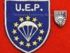 Διακριτικό και καρφίτσα πέτου της ΕΥΡΩΠΑΪΚΗΣ ΕΝΩΣΗΣ ΑΛΕΞΙΠΤΩΤΙΣΤΩΝ (U.E.P.), τα οποία διακριτικά φέρουν τα συμμετέχοντα μέλη στο εν λόγω ευρωπαϊκό πρωτάθλημα (δωρεά κ.Κωννου Κούντη).