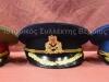 Πηλήκια των Ρουμανικών Ενόπλων Δυνάμεων, από αριστερά πηλήκιο Συνταγματάρχη του Στρατού Ξηράς, πηλήκιο Πλοιάρχου του Πολεμικού Ναυτικού και πηλήκιο Σμηνάρχου της Πολεμικής Αεροπορίας (δωρεά του Επισκόπου κ.Βησσαρίων της Τούλτσεα-Ρουμανίας)