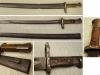 Ξιφολόγχη του Γερμανικού τυφεκίου ''Mauser mod.1880'' που χρησιμοποιήθηκε από τον Σερβικό Στρατό κατά τον 19ο και 20ο αιώνα, και η οποία ξιφολόγχη λόγω του μήκους της χρησιμοποιούνταν και ως σπάθα κυρίως από τους ιππείς (δωρεά κ.Κωννου Δ. Κούντη η οποία ανήκε στον Παππού του Χρήστο Κούντη).