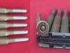 Σπάνιος γεμιστήρας πέντε φυσιγγίων των 6,5χιλ, του Ελληνικού τυφεκίου ''Model 1903 Mannlicher-Schoenauer Carbine, M1903/14'' ,το οποίο τυφέκιο κατασκευάστηκε ειδικά για τον Ελληνικό Στρατό από την ΄΄Steyer΄΄, και χρησιμοποιήθηκε από το 1907 έως το 1941. Τα εν λόγω φυσίγγια της γεμιστήρας, και σύμφωνα με τα στοιχεία του ΄΄πέλματος΄΄ του φυσιγγίου, κατασκευάστηκαν το 1921 από την Εταιρία Ελληνικού Πυριτιδοποιείου και Καλυκοποιείου Μποδοσάκη (δωρεά κ.Γεώργιου Πουσίνη).